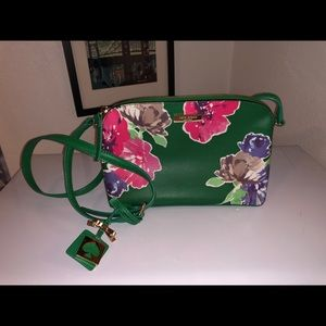Green and hot pink floral print purse.